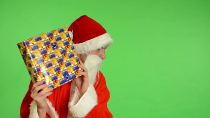 green screen - Santa Claus gets a gift and is surprised
