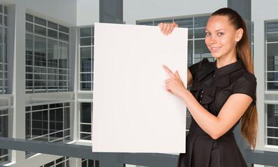 Businesswoman holding empty paper