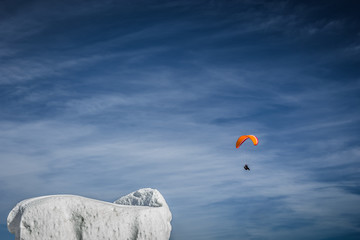 Snow sculpture with paraglider in the background