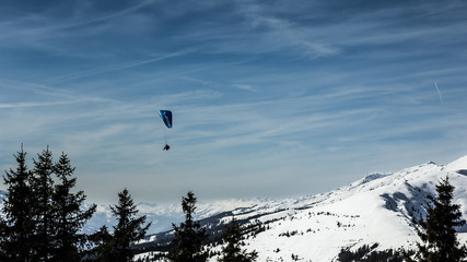 Beautiful mountain view with paraglider