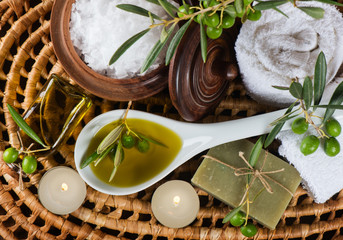 Spa and wellness setting with olive fruits, oil and salt. Top v