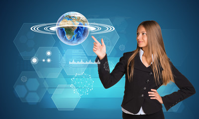 Beautiful businesswoman finger presses Earth. Hexagons and