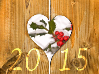2015, wooden frame in the shape of a heart and branch of holly
