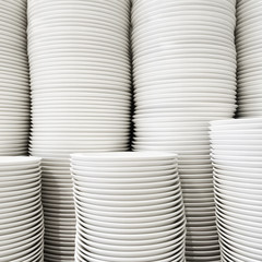 Stacked white plates