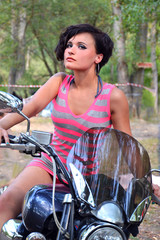 Brunette at the wheel of the bike, portrait