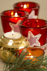 Christmas background with a golden candle
