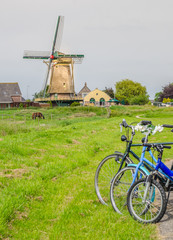Three bicycles with windmill