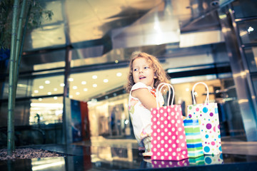 A happy young shopper looking at a display window