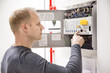 Technician checks fire panel in data center - 72212025