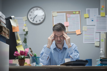 Office worker with headache