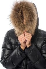 Frau mit Mantel und Fellmütze