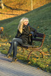 Girl resting on a bench in autumn Park