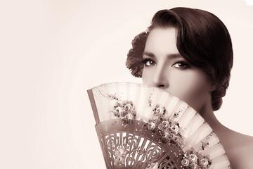 Gypsy Girl. Beauty Fashion Andalusian Woman with Stylish Fan