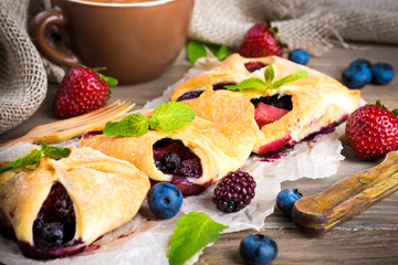 Fruit tarts with berries and fresh mint