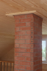 Brick chimney going straight up through the ceiling