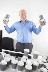 Happy businessman addicted to coffee