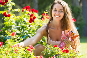 Woman gardening with roses