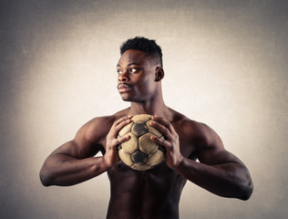 Handsome man holding a soccer ball