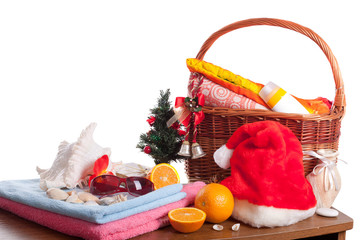 Christmas and beach accessories with basket over white
