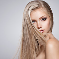 Pretty face of young woman with long white hair