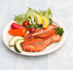 Grilled red fish medallions with vegetables