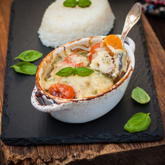 Fish casserole with vegetables in white sauce