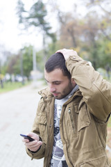 MAn upset looking at his phone