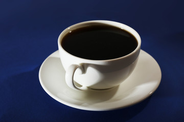 Cup of coffee on blue background