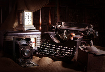 Old typewriter, retro camera and radio receiver