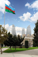 View of the Flame Towers skyscraper with azerbaijan flag in Baku