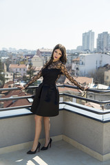 Pretty young woman on the roof