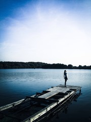 girl standing on the pier