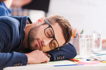 Sleeping at work.
