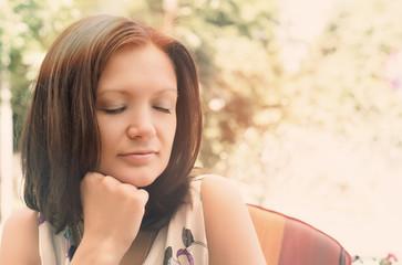 Woman daydreaming in peaceful garden