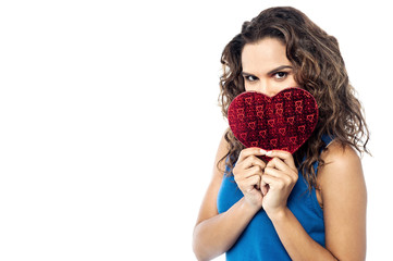 Pretty woman  holding heart shape gift box