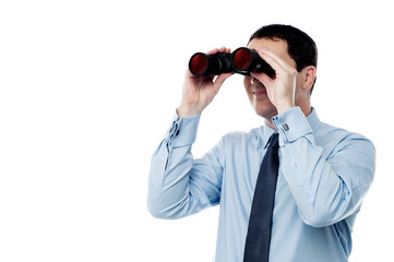 Middle aged  business man with binocular