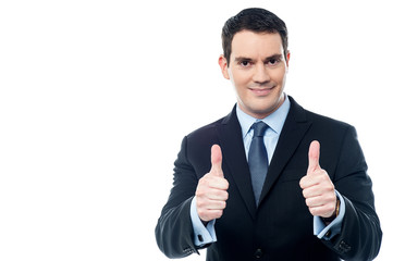 Handsome businessman holds his thumbs up