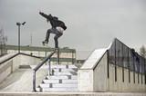 skateboarder trick in skatepark