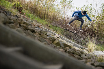 boy doing skateboard trick