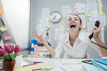 Businesswoman shouting at phone