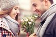Leinwandbild Motiv Romantic couple with flowers