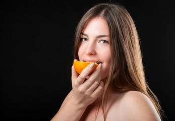 beautiful glad woman and fresh juicy orange