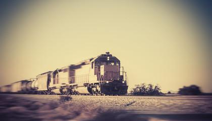 Freight train traveling through desert Arizona