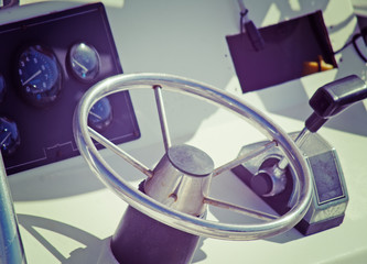 boat steering wheel and throttle in vintage tone