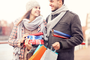 Beautiful couple with Christmas presents