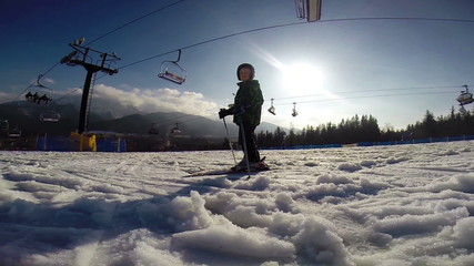 Slow motion footage: Young skier - first steps.
