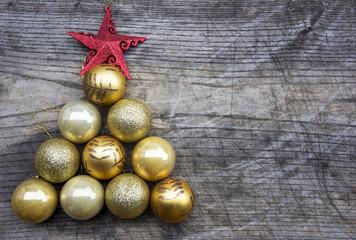 Christmas tree made of golden decoration balls