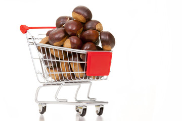 Shopping cart full of chestnuts, isolated on white background