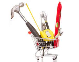 Shopping cart full of construction tools, isolated on white back