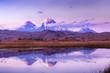 Leinwanddruck Bild - Smoking volcanos reflecting in the lake